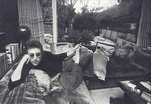 John Lennon poses at his home in Los Angles, in 1973